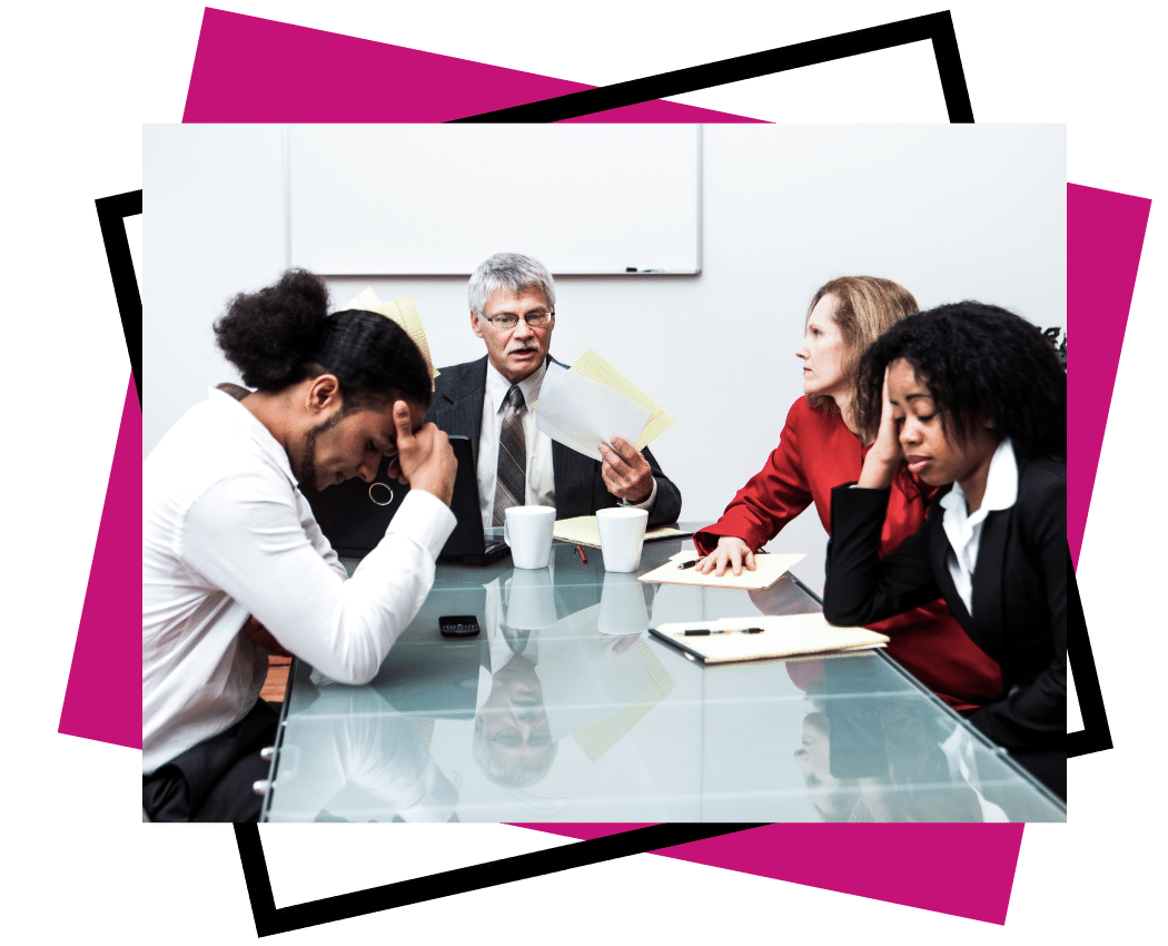 hr policies and procedures - exceler8 - Image of an older man with grey hair at the end of a table with papers talking to frustrated team members around a table